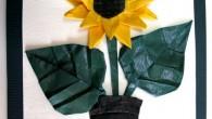 Ръчно направена картичка за рожден ден с оригами слънчоглед в сакция.
